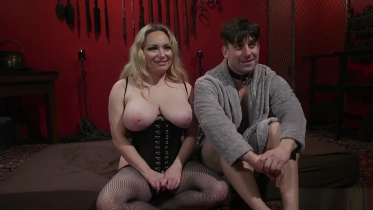 Milf in sexy fishnets strap on fucking her slave