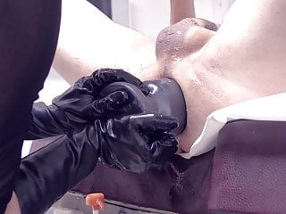 Huge mega strapon, large plug inserted by mistress