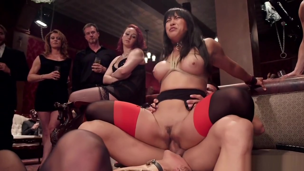 Slaves in lingerie in BDSM orgy