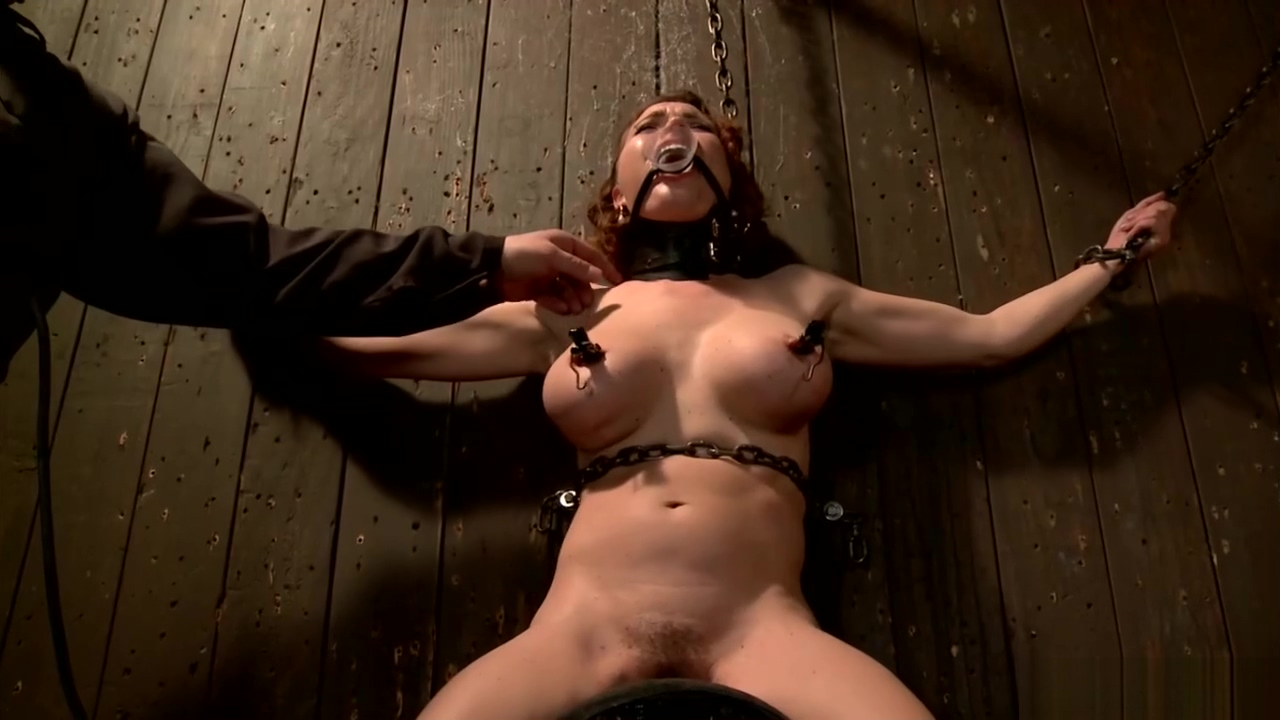Busty redhead slut tormented in dungeon