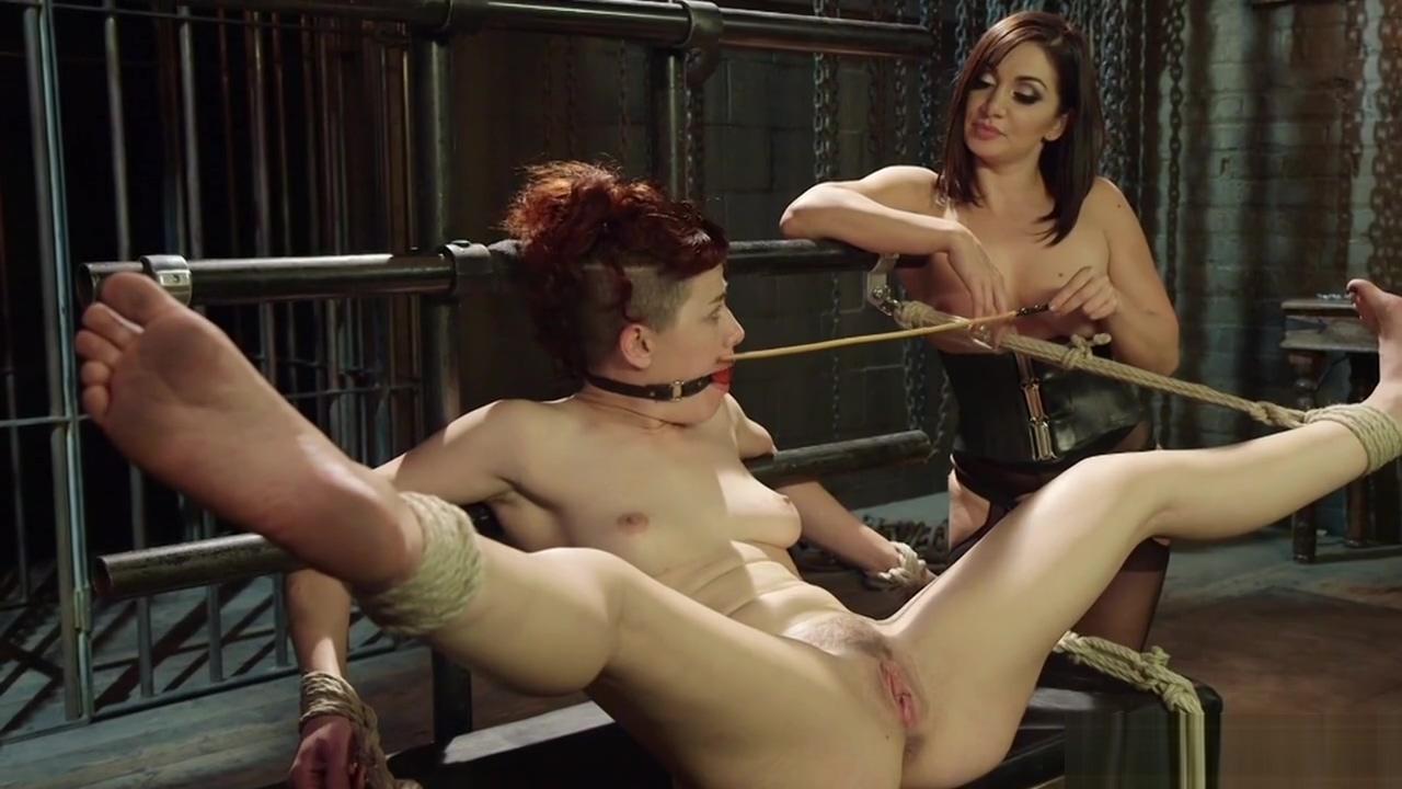 Lezdom in latex whips redhead slave