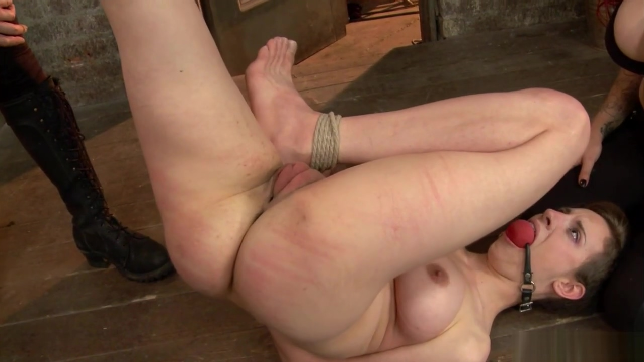 Tied busty slave in threesome lezdom