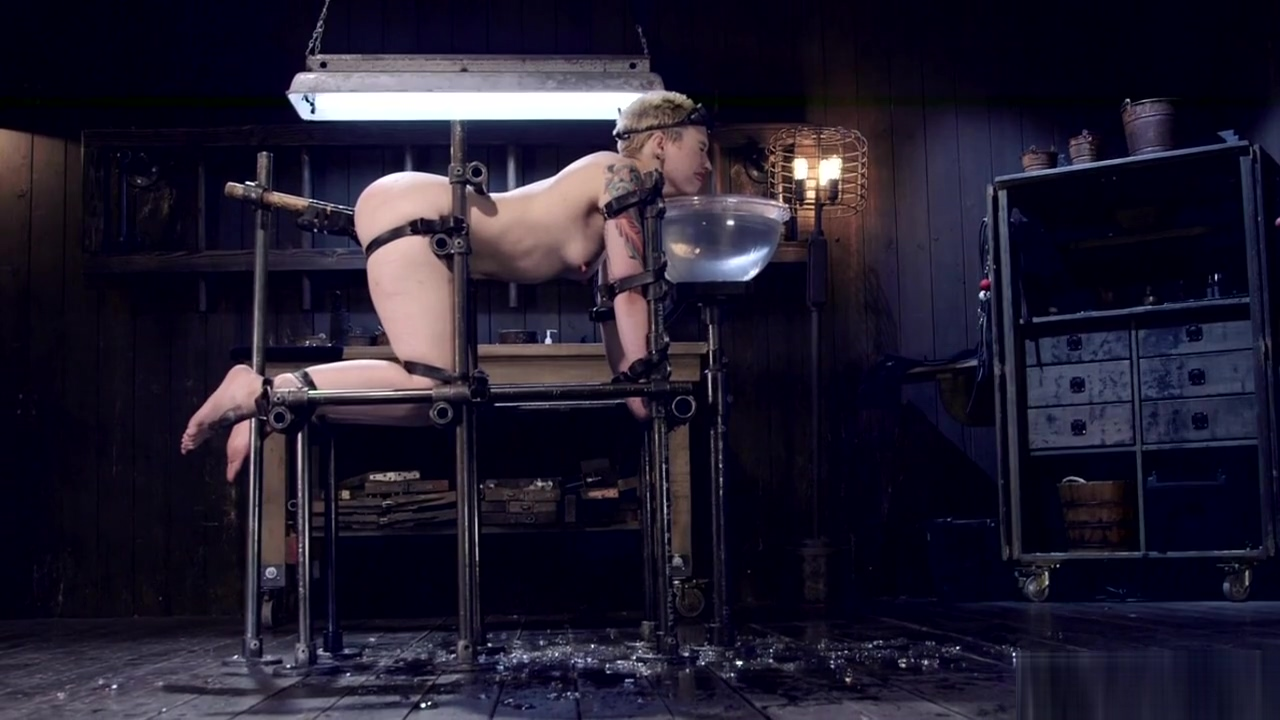 Blonde slave in gas mask gets whipped
