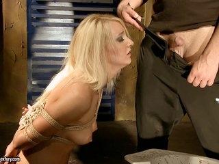 Valerie Follass in a scene of domination
