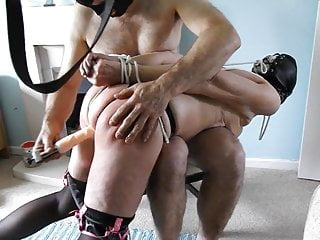 Hooded and tied old slut gets anal hooked and dildoed by two men