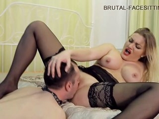 Impressive, Russian woman is wearing black stockings while facesitting a younger guy in her bedroom