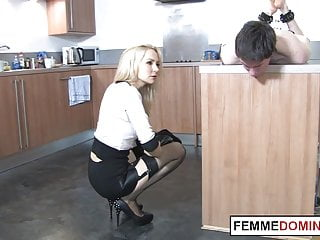 Dominatrix in high heels fucks sub with strapon