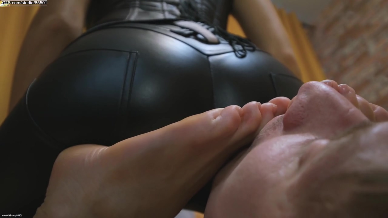 The Girl Sits Beautifully On Her Chest. Slave Licks The Feet Of His Goddess