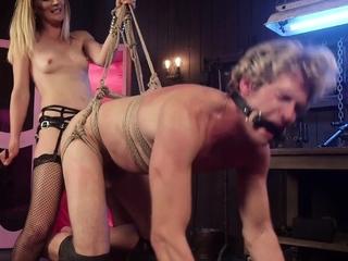 BDSM domme pegging her bound slave