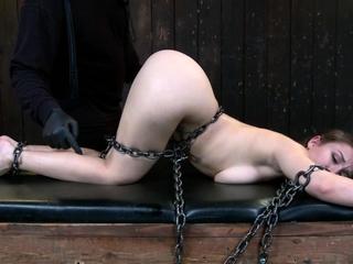 Slut chained and caned device bondage