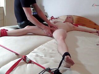 Lili tortured on the bed