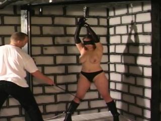 Busty bonded slave girl blindfolded whipped