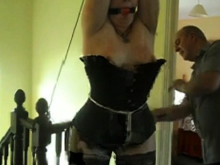 slave Alexa tied to the ceiling and whipped